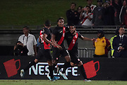 Peru defender Luis Abrahm (2) celebrates with forward Andre Carrillo (18) and midfielder Christofer Gonzales (16) after scoring a goal against Brazil in the second half during an international friendly soccer match, Tuesday, Sept. 10, 2019, in Los Angeles. Peru defeated Brazil 1-0.