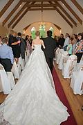 Bride walking down the isle in long flowing dress