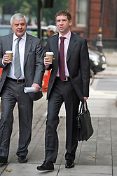 © London News Pictures.  03/10/2013 . London, UK. VLADIMIR ANTONOV (right) arriving at Westminster Magistrates Court in London for the start of his full extradition hearing. Antonov, who is the former owner of Portsmouth Football Club, and his business partner Raimondas Baranauskas, are accused of asset stripping hundreds of millions of pounds from Snoras Bank. Photo credit : Ben Cawthra/LNP