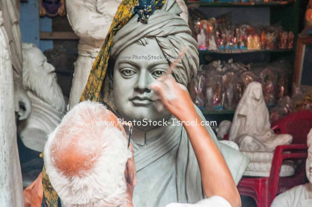 Sculptor working in Kumartuli potters quarter, Kolkata, India