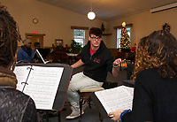 "Patrick Dorow goes through the melodies with his cast for their upcoming Christmas music extravaganza ""Home for the Holidays"" to be presented by Interlakes Theater at the Flying Monkey on December 15th-16th.  (Karen Bobotas/for the Laconia Daily Sun)"