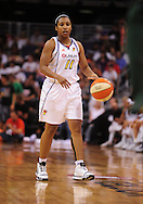 Aug 20, 2010; Phoenix, AZ, USA; Phoenix Mercury guard Katia Swanier (11) dribbles the ball against the Seattle Storm at US Airways Center. The Storm defeated the Mercury 78-73.  Mandatory Credit: Jennifer Stewart-US PRESSWIRE