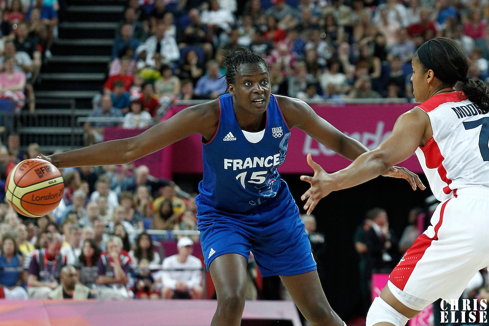 11 August 2012: France Jennifer Digbeu passes the ball past USA Maya Moore during 86-50 Team USA victory over Team France, during the Women's Gold Medal Game, at the North Greenwich Arena, in London, Great Britain.