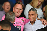 Former Brighton manager Chris Hughton poses for a picture in the stand during the Pre-Season Friendly match between Northampton Town and Sheffield United at the PTS Academy Stadium, Northampton, England on 20 July 2019.
