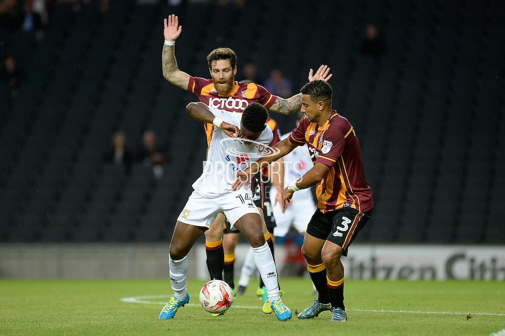 Milton Keynes striker Kieran Agard (14) under pressure from Bradford City defender James Meredith (3)  during the EFL Sky Bet League 1 match between Milton Keynes Dons and Bradford City at stadium:mk, Milton Keynes, England on 16 August 2016. Photo by Dennis Goodwin.