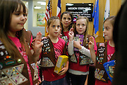 From left to right, Kristen Boris, Kayla Morgan, Brinly Weston, and the rest of Troop 910 recite the Girl Scout Promise and Law with Northeast Texas Girl Scouts CEO Colleen Walker at the Girl Scouts of Northeast Texas.headquarters in Dallas, Texas, on January 10, 2013.  (Stan Olszewski/The Dallas Morning News)