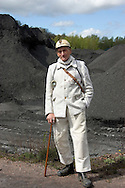 Nederland, Eijgelshoven, 20040419.<br /> Rein Bettink, voormalig mijnwerker. (81), houwer, machinist, particuliere mijn Oranje Nassau I (1937-1974), Heerlen<br /> <br /> meer dan 35 jaar onder de grond gezeten.<br /> Hier gefotografeerd op de bijna afgegraven steenberg van de mijn de Julia nabij de Hopel.<br /> Hij heeft een eigen museum en een grote voorraad aan spullen in zijn kelder.
