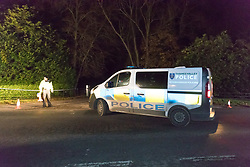 © Licensed to London News Pictures. 17/11/2017. Waddesdon, Buckinghamshire, UK. Police cordon at the entrance to woods on Main Road and Waddesdon Hill in Upper Winchendon, Waddesdon this evening. An aircraft and a helicopter crashed mid-air over Buckinghamshire and a number of casualties have been reported. Photo credit: Vickie Flores/LNP