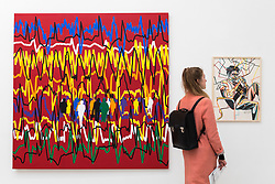 "© Licensed to London News Pictures. 17/05/2019. LONDON, UK. A visitor views ""Le Coeur fait ce qu'il veut Cardiogramme"", 2014, and ""Jean-Michel (Basquiat)"", 2018, by Gérard Fromanger at the Draw Art Fair London, the first fair in the UK dedicated to modern and contemporary drawing.  58 international galleries have juxtaposed drawings with related paintings, sculptures, photos or videos, in a ratio of approximately 70% to 30%, using drawing as the core concept.  The inaugural show is open to the public 17 to 19 May 2019 at the Saatchi Gallery in Chelsea.  Photo credit: Stephen Chung/LNP"
