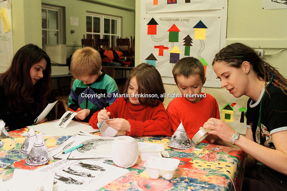 Childcare workers & children at an Out of School Club....© Martin Jenkinson tel 0114 258 6808  mobile 07831 189363 email martin@pressphotos.co.uk  NUJ recommended terms & conditions apply. Copyright Designs & Patents Act 1988. Moral rights asserted credit required. No part of this photo to be stored, reproduced, manipulated or transmitted by any means without prior written permission.