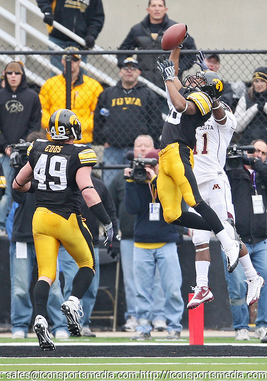 November 21, 2009: Iowa cornerback Shaun Prater (28) breaks up a pass intended for Minnesota wide receiver Troy Stoudermire Jr. (11) as Iowa linebacker A.J. Edds (49) looks on during the second half of the Iowa Hawkeyes 12-0 win over the Minnesota Golden Gophers at Kinnick Stadium in Iowa City, Iowa on November 21, 2009.