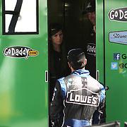 NASCAR Sprint Cup driver Danica Patrick talks with driver Jimmie Johnson in her hauler, prior to her NASCAR Daytona 500 practice session at Daytona International Speedway on Wednesday, February 20, 2013 in Daytona Beach, Florida.  (AP Photo/Alex Menendez)