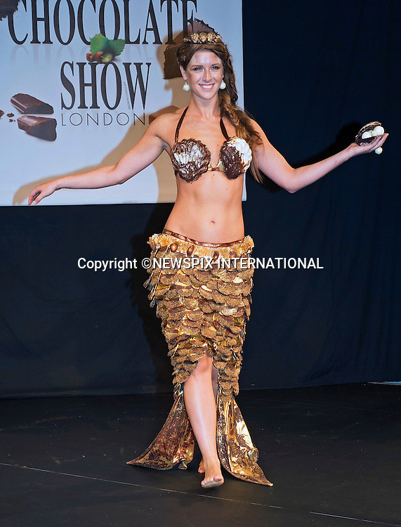 15.10.2015; London, England: CHOCOLATE FASHION SHOW<br /> <br /> Outfits worn for the show were constructed mainly from chocolate and included a mermaid from Aneesh Popat The Chocolatier and another inspired by Doctor Who, created by The Fat Duck.<br /> The mermaid dress titled &quot;The Goddess of the Sea&quot;, featured gold scales dipped in dark chocolate.<br /> The Salon du Chocolat held at Olympia, runs for 3 days until 18th October 2015.<br /> Mandatory Photo Credit: &copy;NEWSPIX INTERNATIONAL<br /> <br /> **ALL FEES PAYABLE TO: &quot;NEWSPIX INTERNATIONAL&quot;**<br /> <br /> PHOTO CREDIT MANDATORY!!: NEWSPIX INTERNATIONAL(Failure to credit will incur a surcharge of 100% of reproduction fees)<br /> <br /> IMMEDIATE CONFIRMATION OF USAGE REQUIRED:<br /> Newspix International, 31 Chinnery Hill, Bishop's Stortford, ENGLAND CM23 3PS<br /> Tel:+441279 324672  ; Fax: +441279656877<br /> Mobile:  0777568 1153<br /> e-mail: info@newspixinternational.co.uk