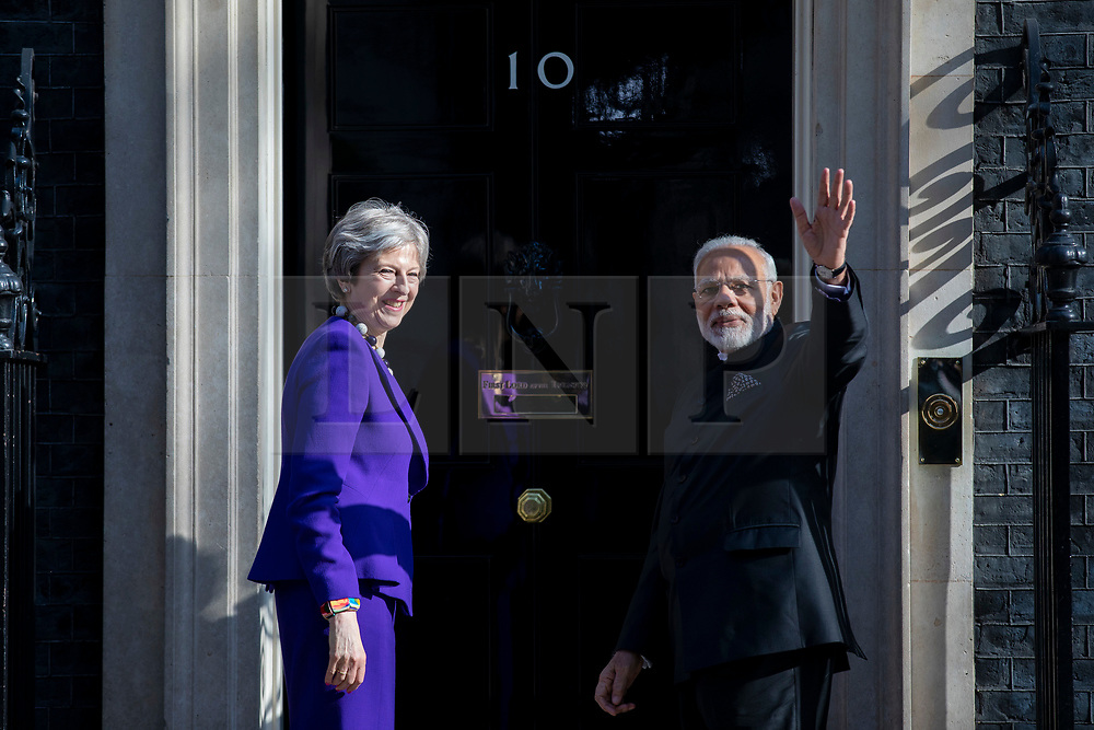 © Licensed to London News Pictures. 18/04/2018. London, UK. Indian Prime Minister Narendra Modi (R) waves as he meets Prime Minister Theresa May (L) at 10 Downing Street. Photo credit: Rob Pinney/LNP