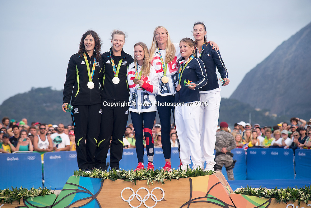 From Left: New Zealand's Jo Aleh and Polly  Powrie Silver, Great Britain's Hannah Mills<br /> Saskia Clark Gold and France's Camille Lecointre and Helene Defrance Bronze celebrate during the medal ceremony for 470 class sailing race the 2016 Rio Olympics on Thursday the 18th of August 2016. &copy; Copyright Photo by Marty Melville / www.Photosport.nzz