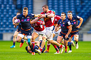 Duhan van der Merwe (#11) of Edinburgh Rugby tries to break clear of Romain Briatte (#6) of SU Agen Rugby during the European Rugby Challenge Cup match between Edinburgh Rugby and SU Agen at BT Murrayfield, Edinburgh, Scotland on 18 January 2020.