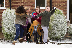 Cobham, Kent, December 22 2017. The Wilson family and friends enjoy a fun packed snow day after winning a TK Maxx Snow Globe. © SWNS