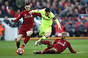 Barcelona forward Lionel Messi (10)  can't escape the attention of Liverpool defender Andrew Robertson (26) and Liverpool midfielder Fabinho (3) during the Champions League semi-final, leg 2 of 2 match between Liverpool and Barcelona at Anfield, Liverpool, England on 7 May 2019.