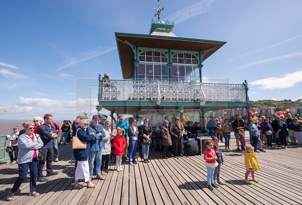 """© Licensed to London News Pictures. 27/05/2019. Clevedon, North Somerset, UK. Clevedon Pier's 150th anniversary event. 2019 marks the 150th Anniversary of the opening of Clevedon Pier, an iconic Victorian structure and Grade 1 listed pier that attracts over 100,000 visitors per year. It was called """"The most beautiful pier in England"""" by poet Sir John Betjeman. Photo credit: Simon Chapman/LNP."""