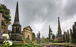 © Licensed to London News Pictures. 21/10/2015. Halifax, UK. David Glover who is the chair of the friends of Lister Lane Cemetery admires one of the Spires in The Victorian Grade 2 listed Lister Lane Cemetery in Halifax that dates back to 1841 & has been recognised as a Significant Cemetery in Europe, one of only 13 in the UK putting it alongside such famous cemeteries as Highgate in London. The cemetery houses burial plots of James Uriah Walker who was the owner of the Halifax Guardian & the first person to publish the Bronte sister's work, The Crossley family who's mill became the largest carpet manufacturing business in the world & numerous veterans of the battle of Waterloo. Photo credit: Andrew McCaren/LNP
