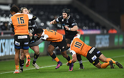 Ospreys' Jeff Hassler tackled by Cheetahs' Clayton Blommetjies and Cheetahs' Malcolm Jaer<br /> <br /> Photographer Mike Jones/Replay Images<br /> <br /> Guinness PRO14 Round Round 16 - Ospreys v Cheetahs - Saturday 24th February 2018 - Liberty Stadium - Swansea<br /> <br /> World Copyright © Replay Images . All rights reserved. info@replayimages.co.uk - http://replayimages.co.uk