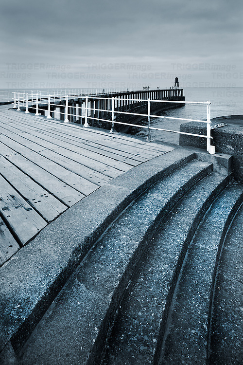 Jetty into the north sea at Whitby, North Yorkshire, England