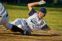 Coeur d'Alene Lumbermen's Chad Nyquist slides into home plate to score during the second game of Tuesday's doubleheader against Prairie in Post Falls.