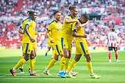 Kwesi Appiah (#9) of AFC Wimbledon celebrates after scoring the equalising goal during the EFL Sky Bet League 1 match between Sunderland and AFC Wimbledon at the Stadium Of Light, Sunderland, England on 24 August 2019.