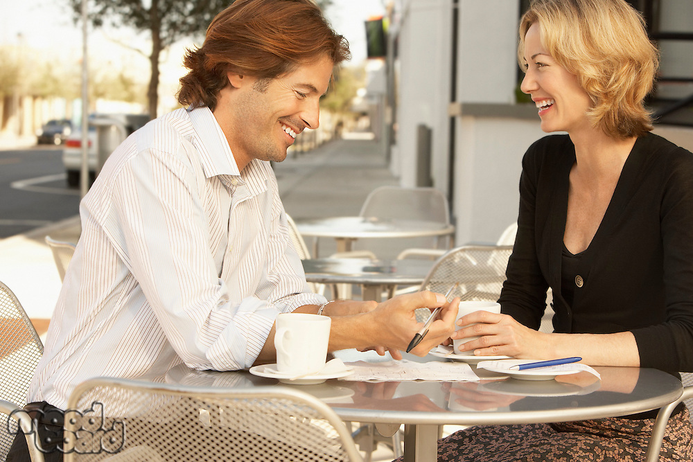 Couple smiling at outdoor cafe