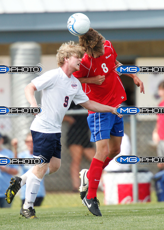 May 10, 2014; Huntsville, AL, USA;  Vestavia Matt Copeland (8) hits the ball with his head as Oak Mountain Mark Green (9) goes for the ball also at John Hunt Soccer Complex. Mandatory Credit: Marvin Gentry