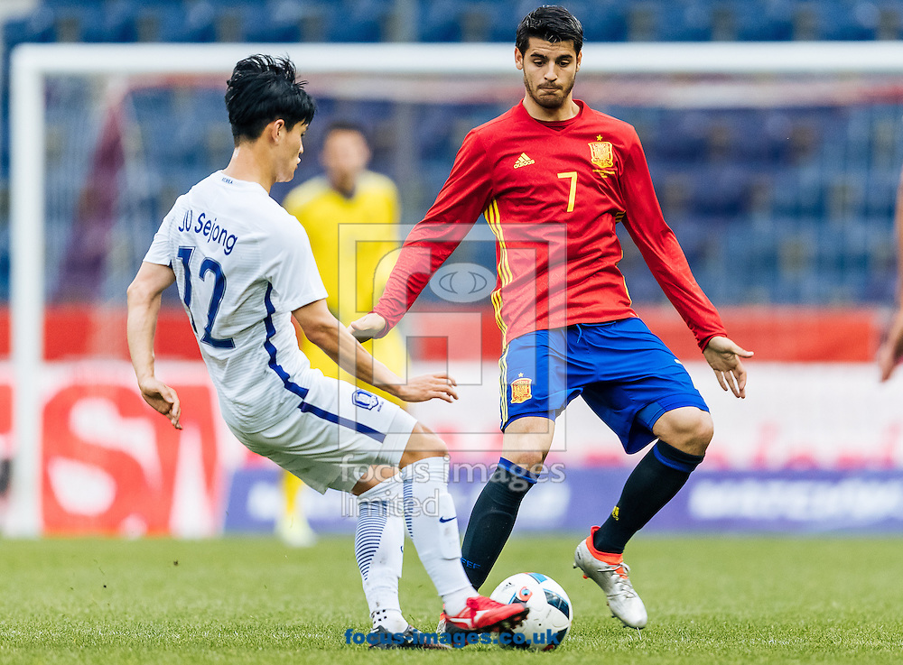 Alvaro Morata of Spain and Se Jong Ju of South Korea during the International Friendly match at Red Bull Arena, Salzburg<br /> Picture by EXPA Pictures/Focus Images Ltd 07814482222<br /> 01/06/2016<br /> ***UK &amp; IRELAND ONLY***<br /> (filename}
