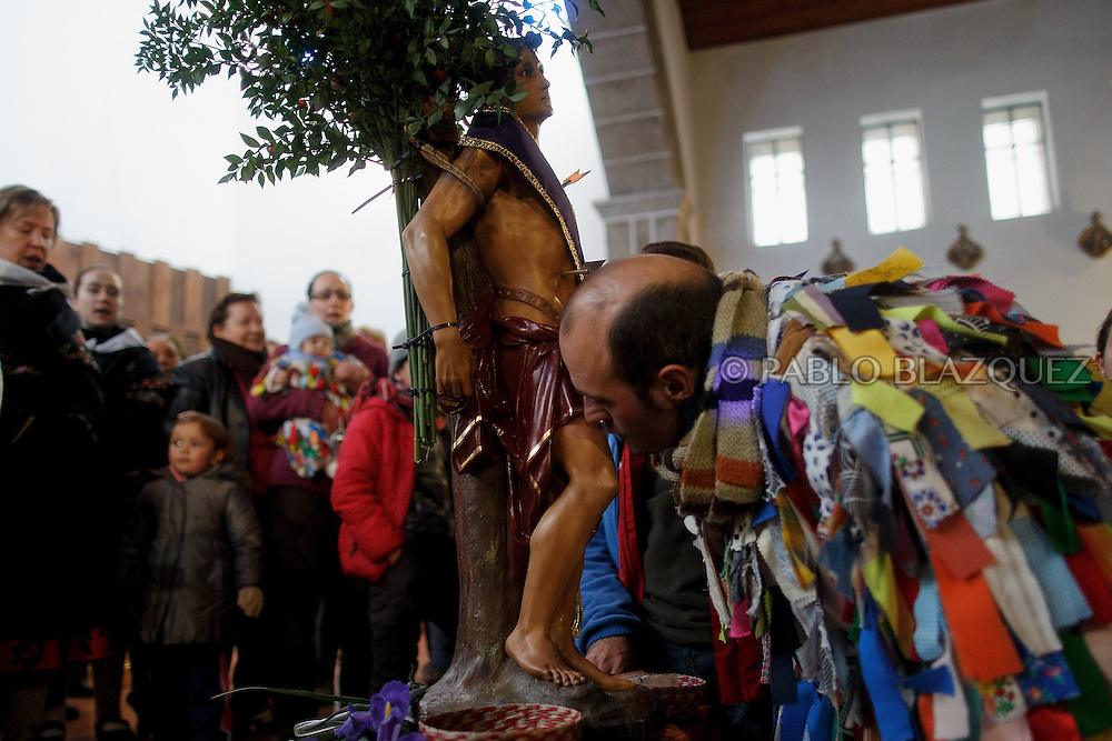 Raul Beites 34, kisses the statue of Saint Sebastian during the Jarramplas Festival inside the church on January 20, 2015 in Piornal, Spain. The centuries old Jarramplas festival takes place annually every January 19-20 on Saint Sebastian Day. Even though the exact origins of the festival are not known, various theories exist including the mythological punishment of Caco by Hercules, a relation to ceremonies celebrated by the American Indians that were seen by the first conquerors, to a cattle thief ridiculed and expelled by his village neighbours. It is generally believed to symbolize the expulsion of everything bad. This year the people who represented Jarramplas were Angel Cerro Fernandez on 19 January and Carlos Calle Rodríguez 47 and Raúl Beites Sánchez 34 on 20 January.