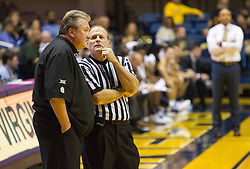 Nov 11, 2016; Morgantown, WV, USA; West Virginia Mountaineers head coach Bob Huggins talks with an referee during the second half against the Mount St. Mary's Mountaineers at WVU Coliseum. Mandatory Credit: Ben Queen-USA TODAY Sports
