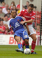 Photo: Leigh Quinnell.<br /> Nottingham Forest v Carlisle United. Coca Cola League 1. 16/09/2006. Carlisle's Karl Hawley gets the ball away from Forest's captain Ian Breckin.