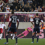 Lee Nguyen. New England Revolution, scores from the penalty spot beating New York Red Bulls keeper Luis Robles  during the New York Red Bulls V New England Revolution, Major League Soccer regular season match at Red Bull Arena, Harrison, New Jersey. USA. 5th October 2013. Photo Tim Clayton