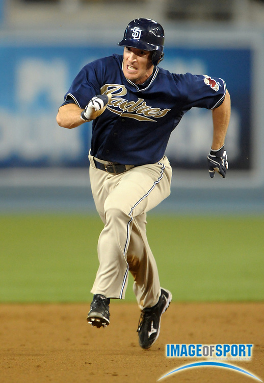 Aug 2, 2010; Los Angeles, CA, USA; San Diego Padres right fielder Chris Denorfia (13) sprints toward third base on a throwing error in the fourth inning against the Los Angeles Dodgers at Dodger Stadium. Photo by Image of Sport