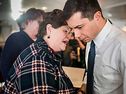 28 JANUARY 2020 - OSCEOLA, IOWA: PETE BUTTIGIEG talks to a woman on the rope line after speaking at a campaign event at the Clarke County Fairgrounds in Osceola, about 50 miles south of Des Moines. Buttigieg talked to a crowd of about 130 people in Osceola. Buttigieg, the former mayor of South Bend, Indiana, is running to be the Democratic nominee for President in the 2020 election. Iowa traditionally holds the first presidential selection event of the 2020 election cycle. The Iowa Caucuses are on Feb. 3, 2020.     PHOTO BY JACK KURTZ
