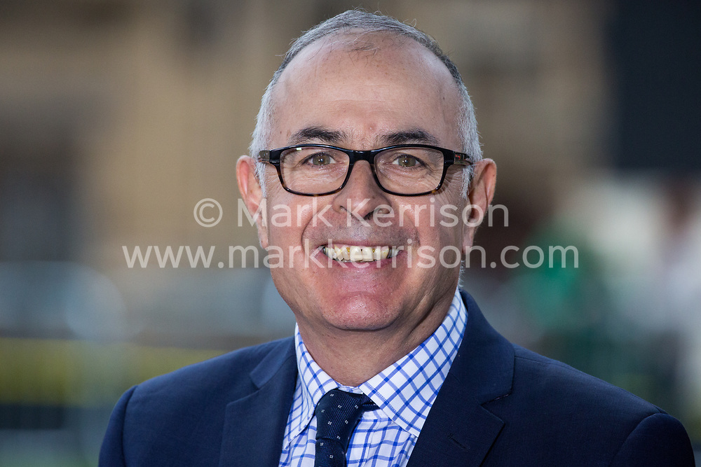 London, UK. 16th November, 2018. Rob Watson, BBC World Service UK Political Correspondent, is interviewed on College Green in Westminster as uncertainty continues around the survival of Prime Minister Theresa May's Government and the number of letters of no confidence submitted to the 1922 Committee.