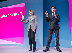© Licensed to London News Pictures . 24/09/2014 . Manchester , UK . Harriet Harman and Ed Miliband stand on the stage at the end of Harriet Harman's speech at the close of the conference . The Labour Party Conference 2014 . Photo credit : Joel Goodman/LNP