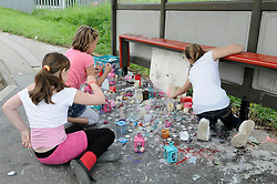 © Licensed to London News Pictures. 09/08/2012 .Children lighting candles and posters on the bus stop near Castle Hill School and The Lindens.. Sixth day (09.08.2012) Tia Sharp has been missing..  12 years old Tia Sharp has been missing from the Lindens on The Fieldway Estate in New Addington,Croydon,Surrey since Friday last week. .Photo credit : Grant Falvey/LNP