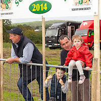 Trevor Forde with his son Donagh and daughter Lauren during the Scarriff Agricultural Show 2014