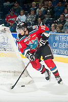 KELOWNA, CANADA - OCTOBER 7: Nick Merkley #10 of Kelowna Rockets skates with the puck behind the net against the Swift Current Broncos on October 7, 2014 at Prospera Place in Kelowna, British Columbia, Canada.  (Photo by Marissa Baecker/Getty Images)  *** Local Caption *** Nick Merkley;