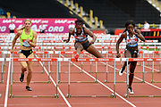 Danielle Williams (JAM) centre, runs to the tape to win the women's 100m hurdles Final equalising the Meeting Record time of 12.46 ahead of Tobi Amusan (NGR) right, and Payton Chadwick (USA) during the Birmingham Grand Prix, Sunday, Aug 18, 2019, in Birmingham, United Kingdom. (Steve Flynn/Image of Sport via AP)
