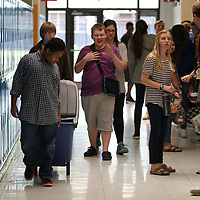Tupelo Middle School student Tony Mays, left, pulls the recycling bin down the hallway so he and his classmates can begin making their ounds to pick up all the paper recycling.