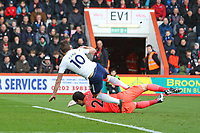 Football - 2017 / 2018 Premier League - AFC Bournemouth vs. Tottenham Hotspur<br /> <br /> Harry Kane of Tottenham gets to the ball ahead of Bournemouth's Asmir Begovic to score only for the goal to be ruled offside but also to pick up an injury from the challenge at Dean Court (Vitality Stadium) Bournemouth <br /> <br /> COLORSPORT/SHAUN BOGGUST