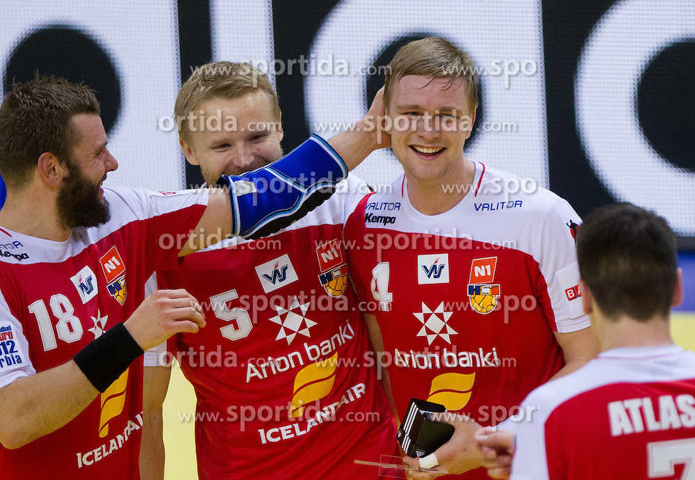 Robert Gunnarsson of Iceland, Ingimundur Ingimundarson of Iceland and Aron Palmarsson of Iceland celebrate after the handball match between Iceland and Norway in  2nd Round of Preliminary Round of 10th EHF European Handball Championship Serbia 2012, on January 18, 2012 in Millennium Center, Vrsac, Serbia. Iceland defeated Slovenia 34-32. (Photo By Vid Ponikvar / Sportida.com)