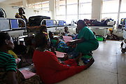 A lot of the wards in Mulago Hospital are so busy that patients have to sit or sleep on the floor because there aren't enough beds.<br /> <br /> A big contributing factor to this is that 60% of the cases at the hospital are referrals from other hospitals outside the city of Kampala.