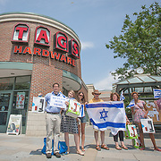 A group of pro-Israel activists, mainly made up of local students, counter protest a recent pro-Palestinian campaign to boycott a local store. The pro-Palestinian activists disagreed with the store's decision to sell Sodastream, an Israeli company. The pro-Israel group responded by purchasing a number of Sodastream products at Tags Hardwear on July 13, 2014 in Cambridge, Massachusetts. Events escalated when a pro-Israel activist was assaulted, and police were called. (Photo by Elan Kawesch/The Times of Israel)