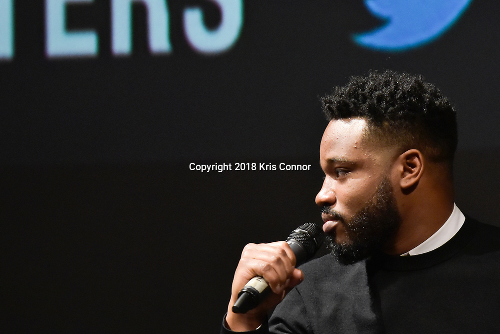 """Director Ryan Coogler joins moderator  Ta-Nehisi Coates in discussion following a special advance screening of """"Black Panther"""" on Sunday, February 11 for Howard University students at the National Air and Space Museum in Washington, D.C. (Kris Connor for Disney)"""
