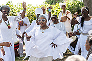 Descendants of enslaved Africans brought to Charleston in the Middle Passage dance to honor their relatives lost during a remembrance ceremony along the saltwater marsh June 10, 2017 in Sullivan's Island, South Carolina. The Middle Passage refers to the triangular trade in which millions of Africans were shipped to the New World as part of the Atlantic slave trade. An estimated 15% of the Africans died at sea and considerably more in the process of capturing and transporting. The total number of African deaths directly attributable to the Middle Passage voyage is estimated at up to two million African deaths.